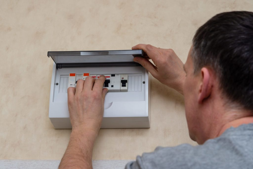Kelowna electrician installing surge protector