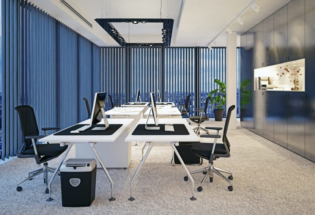 Neat monochrome office space with partially opened slit blinds