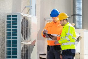 Electricians checking commercial electrical safety checklist
