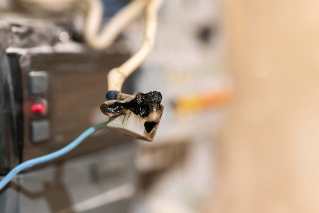 Common electrical code violation with burnt wire