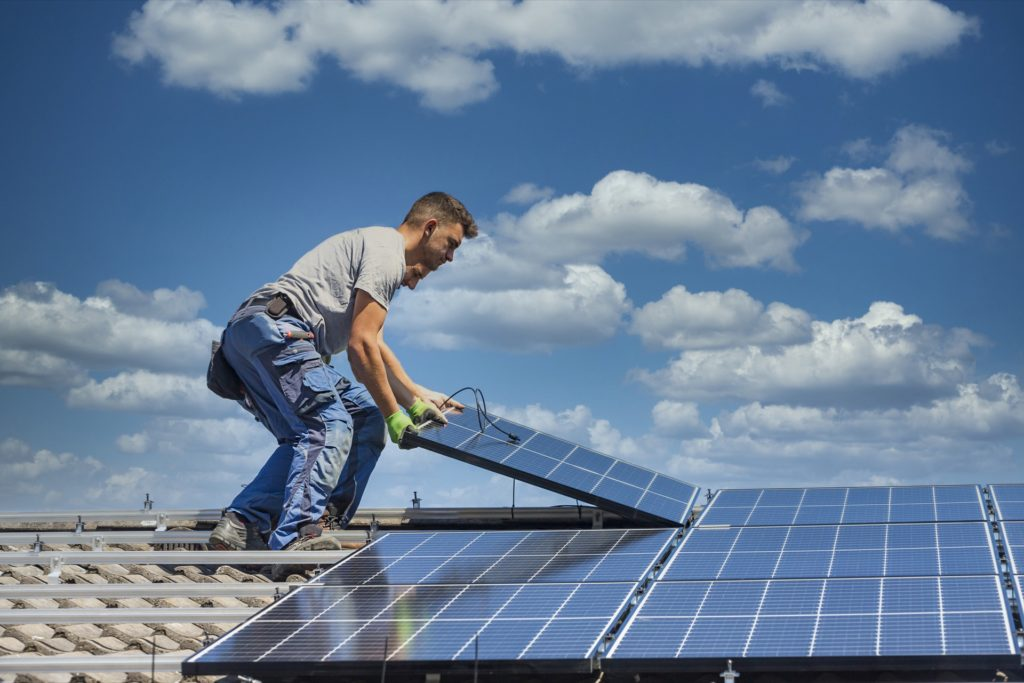 Electrician on call installing solar panels on new home