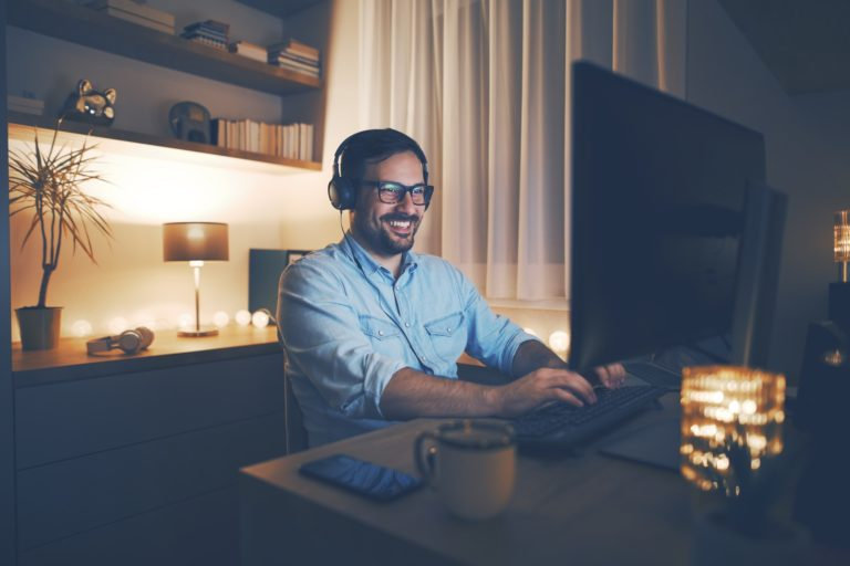 Man working with task lighting at home