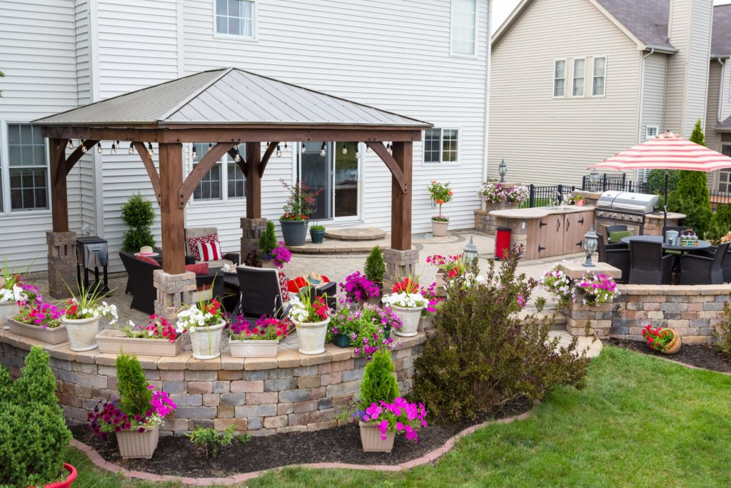 Patio with outdoor string lighting set up by outdoor lighting electrician